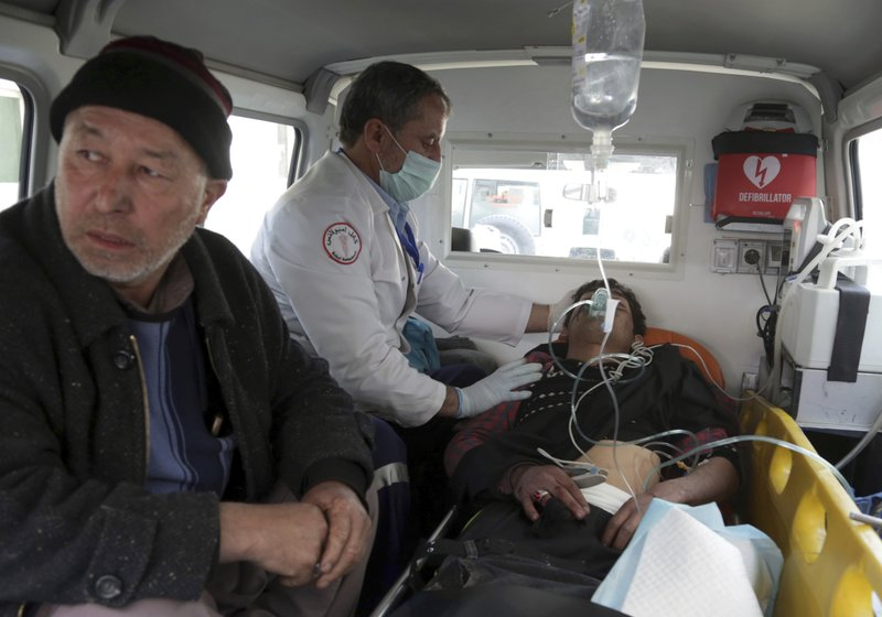 A man injured by an explosion is treated in an ambulance, in Kabul, Afghanistan, Thursday, March 7, 2019. (AP Photo/Rahmat Gul)