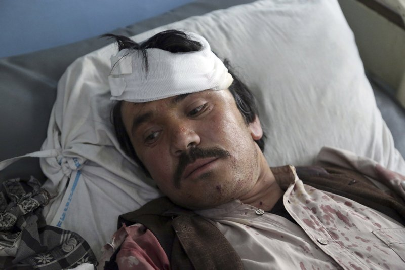 A man wounded in an explosion lies on a bed at a hospital in Kabul, Afghanistan, Thursday, March 7, 2019. (AP Photo/Rahmat Gul)