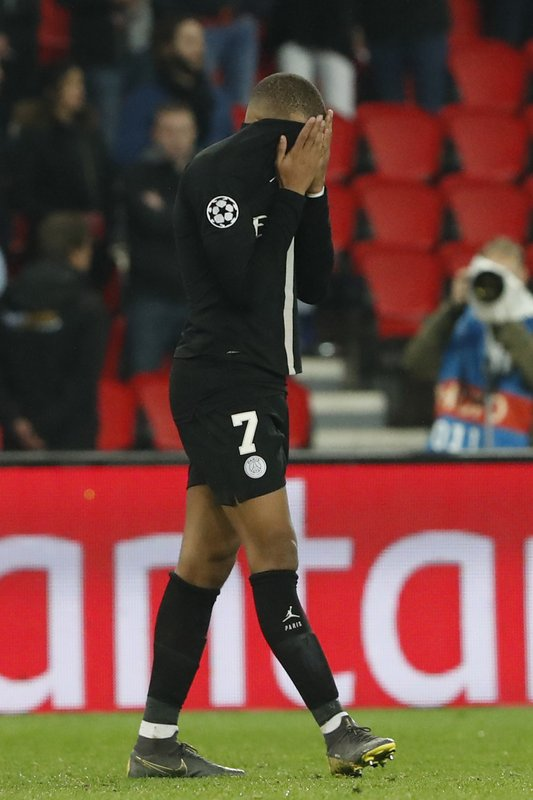 PSG forward Kylian Mbappe reacts end of the Champions League round of 16, 2nd leg, soccer match between Paris Saint Germain and Manchester United at the Parc des Princes stadium in Paris, France, Wednesday, March. (AP Photo/Thibault Camus)
