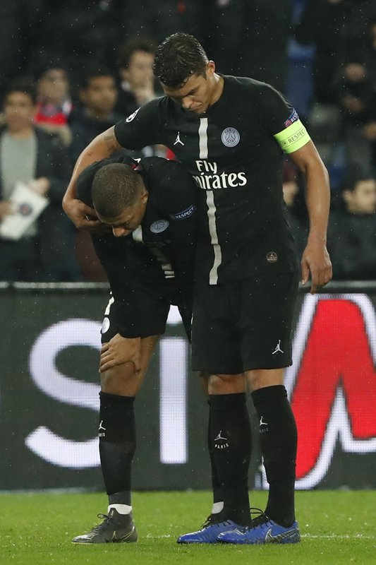 PSG defender Thiago Silva, right, and PSG forward Kylian Mbappe react end of the Champions League round of 16, 2nd leg, soccer match between Paris Saint Germain and Manchester United at the Parc des Princes stadium in Paris, France, Wednesday, March. (AP Photo/Thibault Camus)