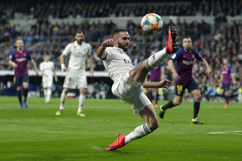 Real defender Dani Carvajal tries to control the ball during the Copa del Rey semifinal second leg soccer match between Real Madrid and FC Barcelona at the Bernabeu stadium in Madrid, Wednesday, Feb. (AP Photo/Manu Fernandez)