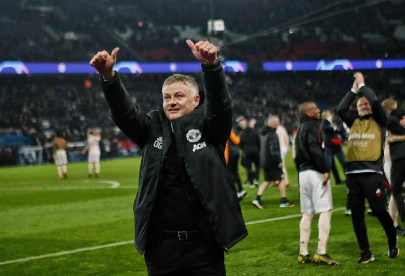 Manchester United caretaker head coach Ole Gunnar Solskjaer celebrates after the Champions League round of 16, second leg soccer match between Paris Saint Germain and Manchester United at the Parc des Princes stadium in Paris, France, Wednesday, March. (AP Photo/Francois Mori)