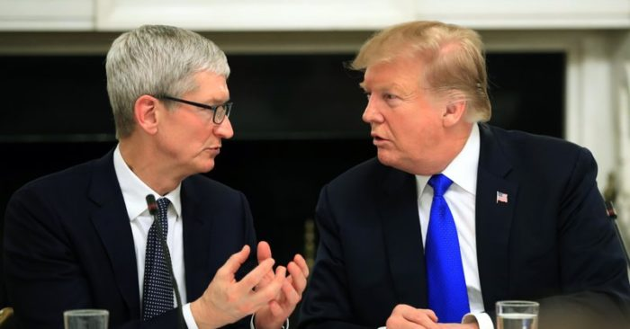FILE—President Donald Trump talks to Apple Inc. CEO Tim Cook during the American Workforce Policy Advisory Board's first meeting in the State Dining Room of the White House, on March 6, 2019. (Manuel Balce Ceneta/AP Photo, File)