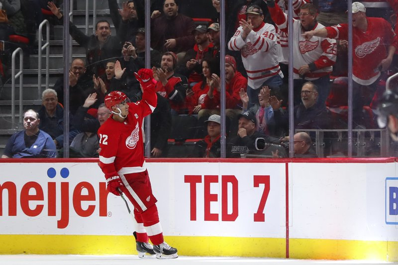 Detroit Red Wings center Andreas Athanasiou celebrates his shootout goal against the New York Rangers during an NHL hockey game Thursday, March 7, 2019, in Detroit. (AP Photo/Paul Sancya)