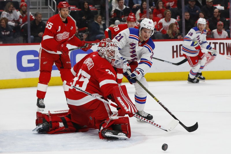 Detroit Red Wings goaltender Jimmy Howard (35) deflects a shot by New York Rangers center Brett Howden (21) during the first period of an NHL hockey game Thursday, March 7, 2019, in Detroit. (AP Photo/Paul Sancya)