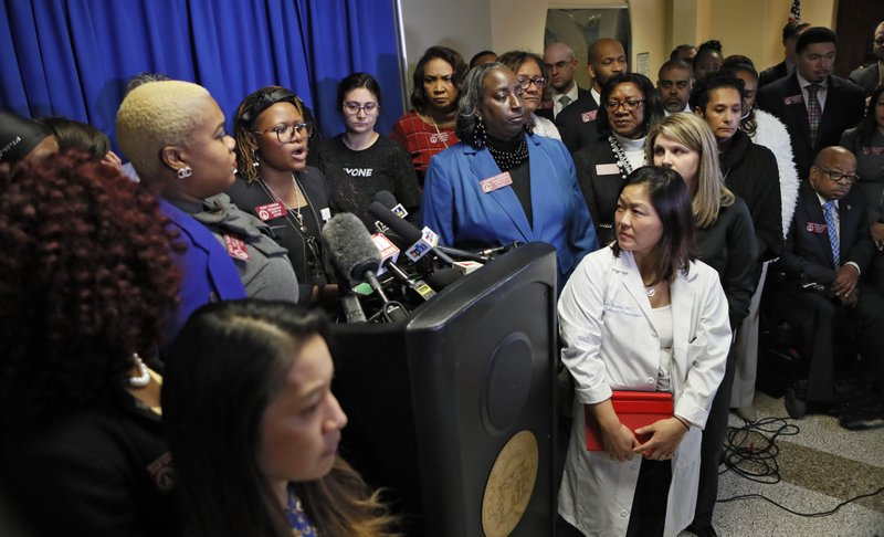 Opponents to HB 481 hold a press conference led off by Rep. Park Cannon, at podium, D - Atlanta. The bill would severely restrict abortions. (Bob Andres/Atlanta Journal-Constitution via AP)