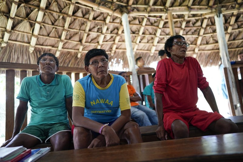 Waimiri-Atroari elders attend a hearing about alleged crimes committed by the Brazilian dictatorship in the 1970s inside a traditional