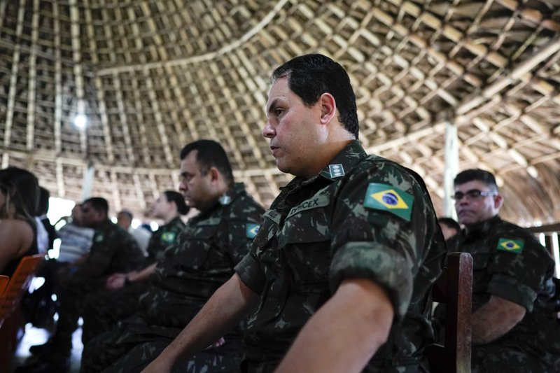Military officers listen to the testimony of Temehe Tomas Waimiri about alleged crimes committed by Brazil's dictatorship in the 1970s during a hearing on the Waimiri-Atroari reserve, in Brazil's Amazon state, Wednesday, Feb. (AP Photo/Victor R. Caivano)