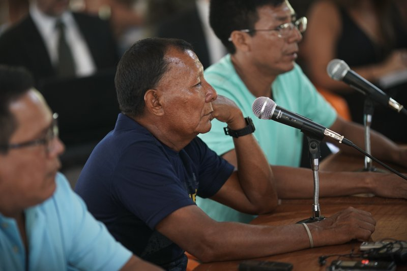 Bare Bornaldo Waimiri sits before a microphone as he gives testimony about alleged crimes committed by the Brazilian dictatorship in the 1970s during a hearing on the Waimiri-Atroari reserve in Brazil's Amazon state, Wednesday, Feb. (AP Photo/Victor R. Caivano)