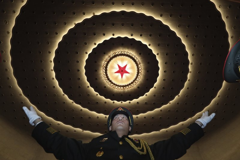 In this March 3, 2019, photo, a Chinese military band conductor leads the band to rehearse before the opening session of the Chinese People's Political Consultative Conference (CPPCC), in Beijing's Great Hall of the People. (AP Photo/Ng Han Guan, File)