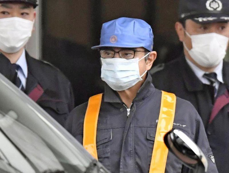 In this March 4, 2019, photo, former Nissan Chairman Carlos Ghosn, center with blue cap, leaves Tokyo's Detention Center in Tokyo, Wednesday, March 6, 2019. ($8.9 million) in bail. (Yu Nakajima/Kyodo News via AP, File)