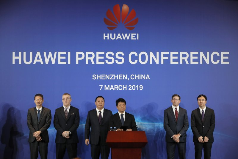 In this March 7, 2019, photo, Huawei Rotating Chairman Guo Ping, center, speaks in front of other executives during a press conference in Shenzhen city, China's Guangdong province. (AP Photo/Kin Cheung, File)