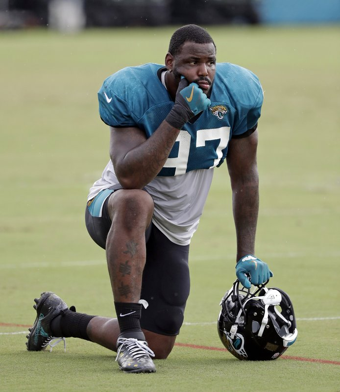 FILE - In this July 31, 2018, file photo, Jacksonville Jaguars defensive tackle Malik Jackson takes a break during a practice at NFL football training camp, Tuesday,, in Jacksonville, Fla. (AP Photo/John Raoux, File)