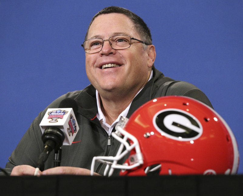 FILE - In this Dec 30, 2018, file photo, Georgia's offensive coordinator Jim Chaney takes questions during a news conference for the Sugar Bowl NCAA college football game against Texas in New Orleans. (Curtis Compton/Atlanta Journal-Constitution via AP, File)