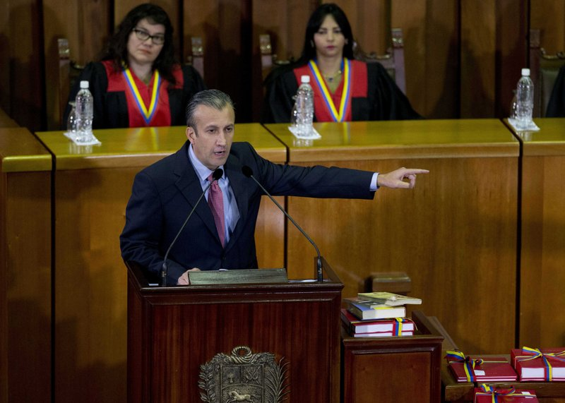 FILE - In this March 3, 2017 file photo, Venezuela's Vice President Tareck El Aissami, center, delivers his state of the nation report at the Supreme Court in Caracas, Venezuela. (AP Photo/Ariana Cubillos, File)