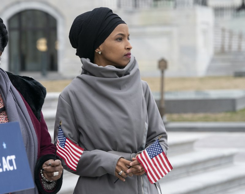 Rep. Ilhan Omar, D-Minn., stands with fellow Democrats as they rally outside the Capitol ahead of passage of H. (AP Photo/J. Scott Applewhite)