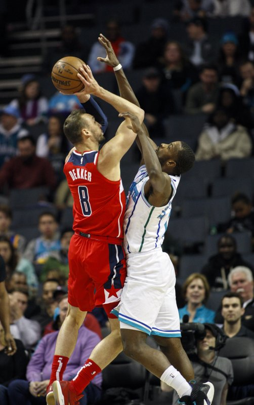Washington Wizards forward Sam Dekker (8) shoots over Charlotte Hornets forward Michael Kidd-Gilchrist in the first half of an NBA basketball game in Charlotte, N. (AP Photo/Nell Redmond)