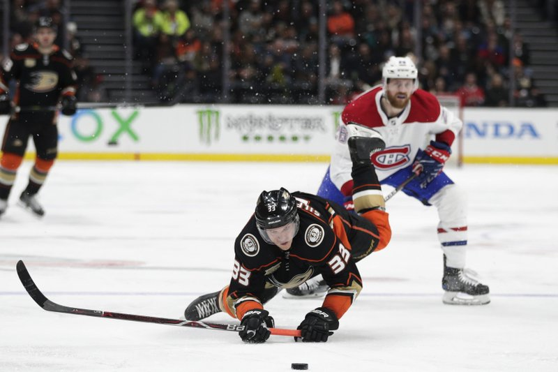 Anaheim Ducks' Jakob Silfverberg, front, of Sweden, falls to the ice while chasing the puck past Montreal Canadiens' Jeff Petry during the second period of an NHL hockey game Friday, March 8, 2019, in Anaheim, Calif. (AP Photo/Jae C. Hong)