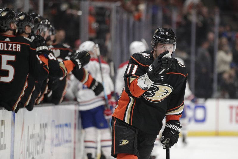 Anaheim Ducks' Daniel Sprong, of the Netherlands, points to goaltender John Gibson while celebrating his goal during the first period of the team's NHL hockey game against the Montreal Canadiens on Friday, March 8, 2019, in Anaheim, Calif. (AP Photo/Jae C. Hong)