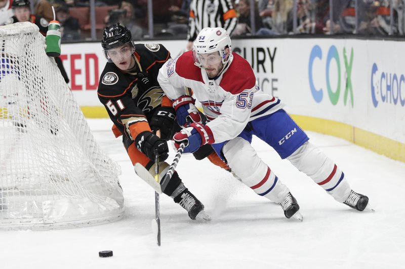 Montreal Canadiens' Victor Mete, right, moves the puck as Anaheim Ducks' Troy Terry defends during the second period of an NHL hockey game Friday, March 8, 2019, in Anaheim, Calif. (AP Photo/Jae C. Hong)