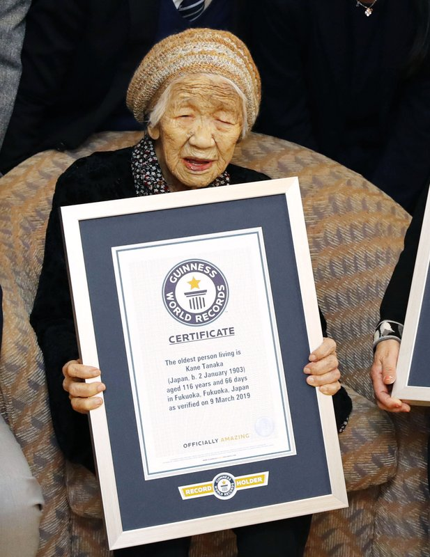 Kane Tanaka, a 116-year-old Japanese woman, poses with her Guinness World Records certificate at a nursing home where she lives in Fukuoka, southwestern Japan, Saturday, March 9, 2019. (Takuto Kaneko/Kyodo News via AP)