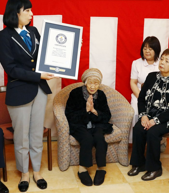 Kane Tanaka, a 116-year-old Japanese woman, puts her hands together as she receives a Guinness World Records certificate at a nursing home where she lives during a ceremony in Fukuoka, southwestern Japan, Saturday, March 9, 2019. (Takuto Kaneko/Kyodo News via AP)
