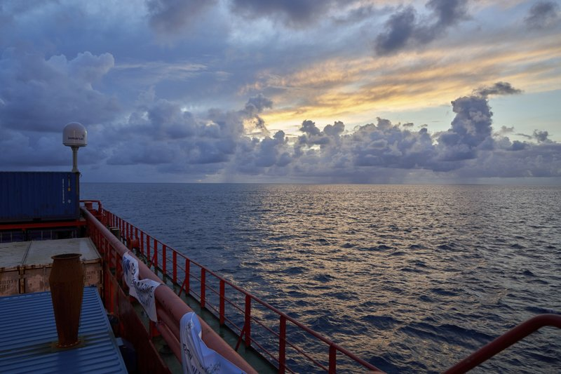 Sun rises near the tiny atoll of Alphonse where scientists onboard the Ocean Zephyr began exploring the depths of the Indian Ocean, Thursday March 7, 2019. (AP Photo/David Keyton)