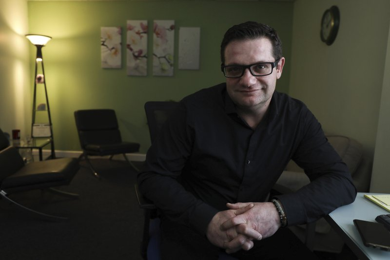 This Feb. 21, 2019 photo shows Lucien Izraylov, an addiction counselor and former heroin user, in his office in Evanston, Ill. (Abel Uribe/Chicago Tribune via AP)