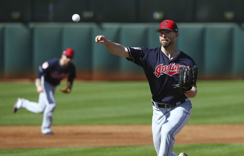 FILE - In this Feb. 18, 2019 file photo, Cleveland Indians starting pitcher Corey Kluber throws a pitch at the Indians spring training baseball facility in Goodyear, Ariz. (AP Photo/Ross D. Franklin, File)