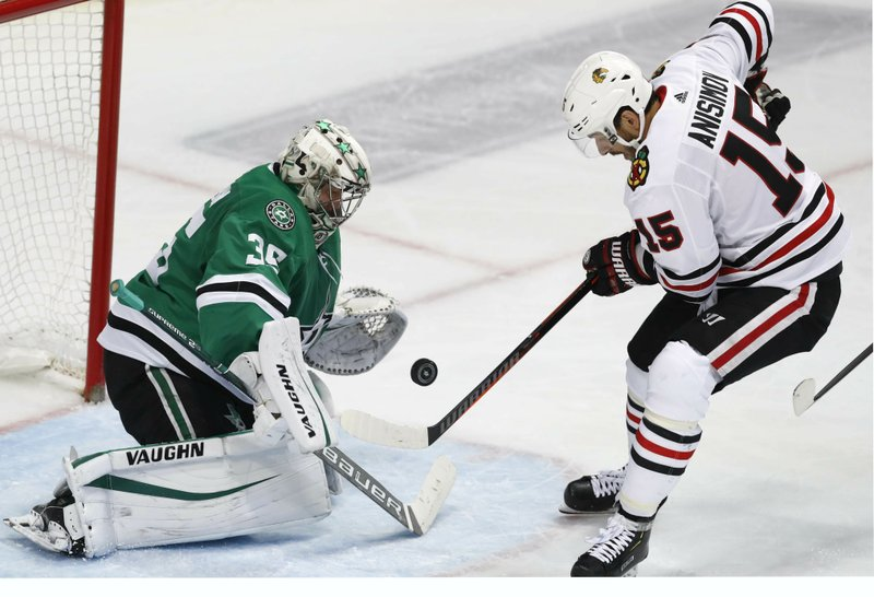 Chicago Blackhawks center Artem Anisimov (15) attacks the goal against Dallas Stars goaltender Anton Khudobin (35) during the second period of an NHL hockey game in Dallas, Saturday, March 9, 2019. (AP Photo/LM Otero)