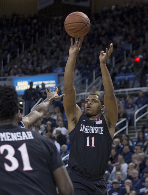 San Diego State forward Matt Mitchell (11) shoots against Nevada in the first half of an NCAA college basketball game in Reno, Nev. (AP Photo/Tom R. Smedes)