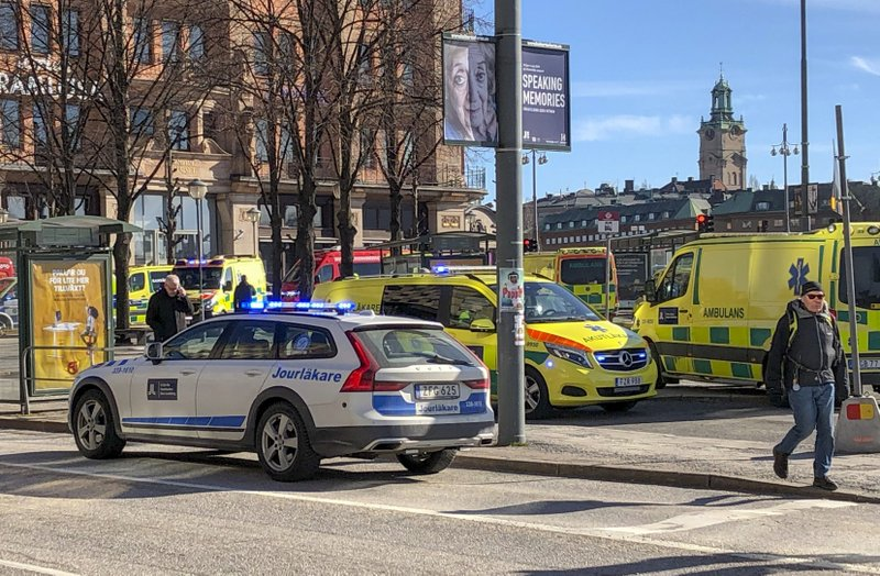 Emergency service vehicles gather after a bus exploded and caught fire on Tegelbacken in central Stockholm, Sweden on Sunday March 10, 2019. (Tomas Bengtsson/TT via AP)
