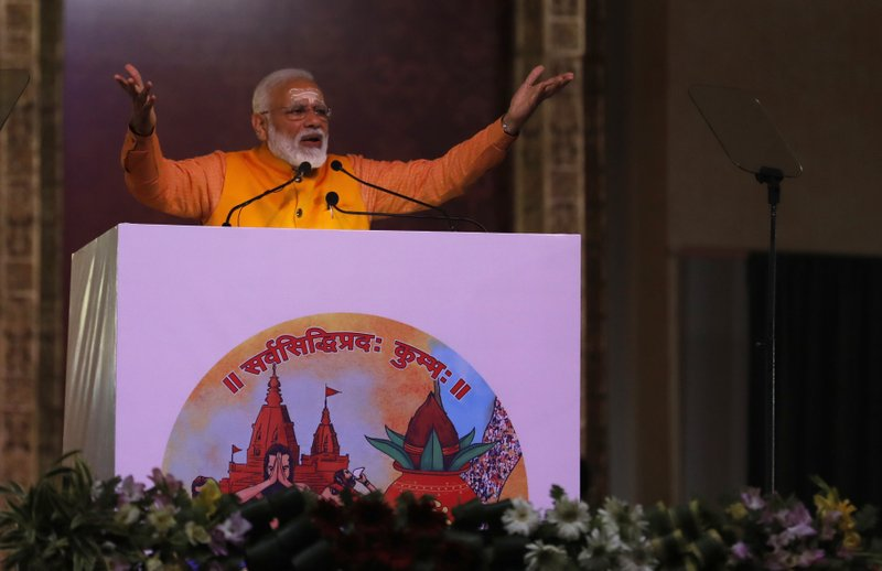 In this Sunday, Feb. 24, 2019 photo, Indian Prime Minister Narendra Modi, speaks after taking a holy dip at Sangam, the confluence of the Rivers Ganges, Yamuna and mythical Saraswati, during Kumbh festival, in Allahabad, India. (AP Photo/ Rajesh Kumar Singh)