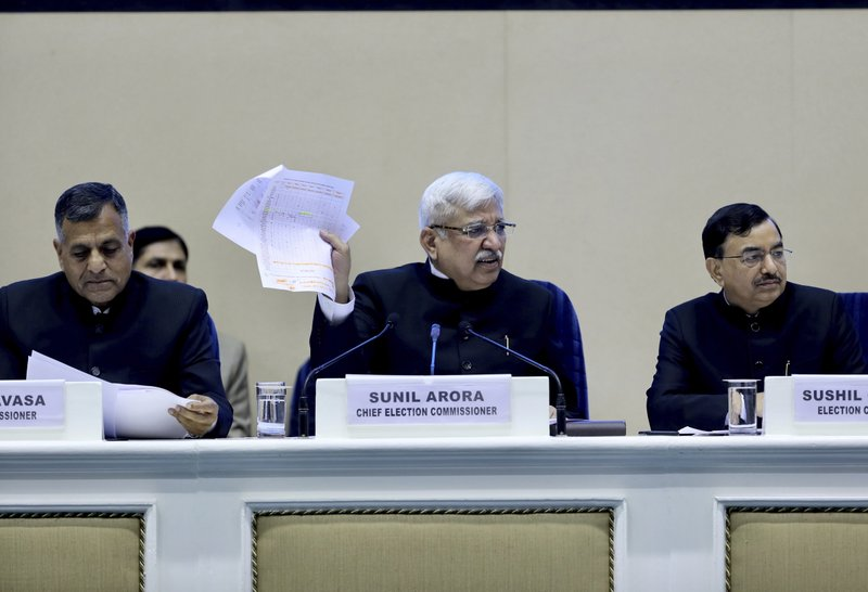 India's Chief Election Commissioner Sunil Arora, center, speaks during a press conference in New Delhi, India, Sunday, March 10, 2019. (AP Photo/ Manish Swarup)