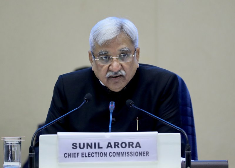 India's Chief Election Commissioner Sunil Arora listens to a question from a journalist during a press conference in New Delhi, India, Sunday, March 10, 2019. (AP Photo/ Manish Swarup)