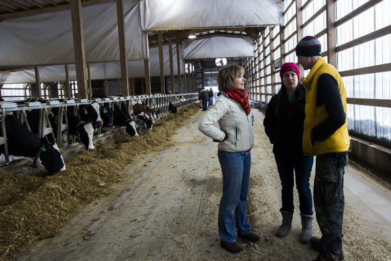 U.S. Sen. Tina Smith, left, talks with Katie and Rob Kreidermacher during a visit to view storm damage caused by extreme snowfall on their farm, Saturday, March 9, 2019, near Altura, Minn. (Andrew Link/The Rochester Post-Bulletin via AP)