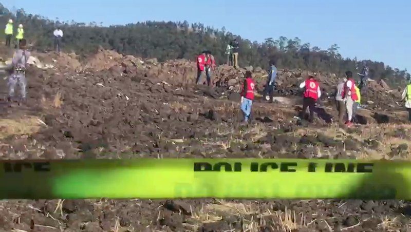 In this image taken from video, rescuers search through wreckage at the scene of an Ethiopian Airlines flight that crashed shortly after takeoff at Hejere near Bishoftu, or Debre Zeit, some 50 kilometers (31 miles) south of Addis Ababa, in Ethiopia Sunday, March 10, 2019. (AP Photo/Yidnek Kirubel)