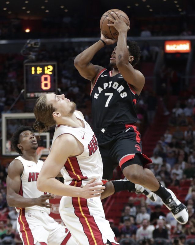 Toronto Raptors guard Kyle Lowry (7) shoots over Miami Heat forward Kelly Olynyk during the first half of an NBA basketball game, Sunday, March 10, 2019, in Miami. (AP Photo/Lynne Sladky)