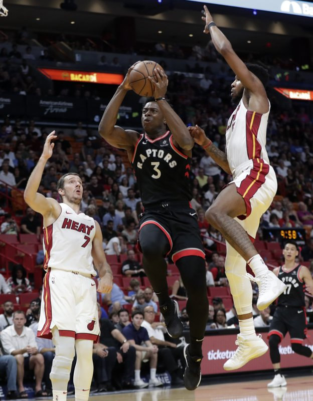 Toronto Raptors forward OG Anunoby (3) droves to the basket as Miami Heat forward Derrick Jones Jr., right, defends during the first half of an NBA basketball game, Sunday, March 10, 2019, in Miami. (7). (AP Photo/Lynne Sladky)
