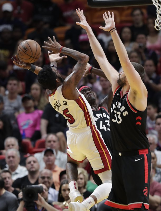 Miami Heat forward Derrick Jones Jr. (5) attempts a shot as Toronto Raptors forward Pascal Siakam (43) and center Marc Gasol (33) defend during the first half of an NBA basketball game, Sunday, March 10, 2019, in Miami. (AP Photo/Lynne Sladky)
