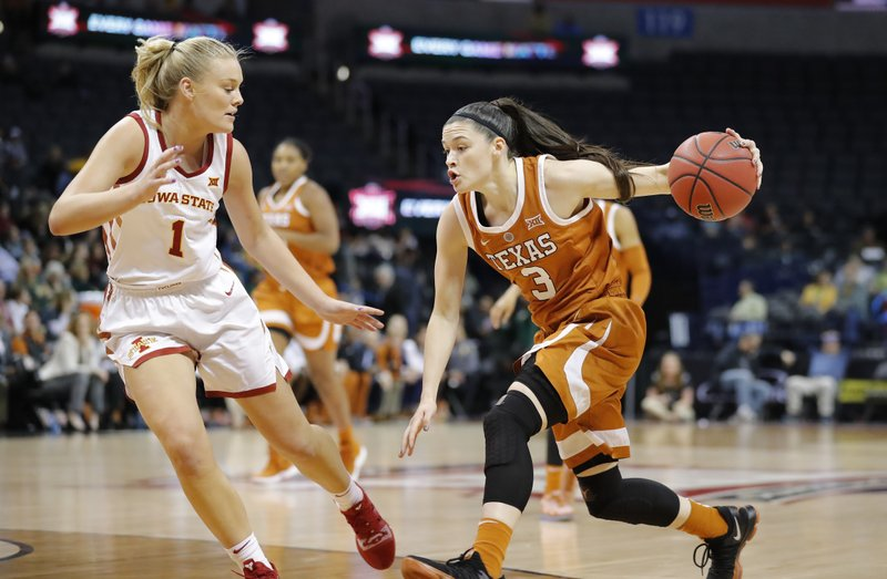 Texas guard Danni Williams (3) drives to the basket as Iowa State forward Madison Wise (1) defends during the first half of an NCAA college basketball game in the Big 12 women's conference tournament in Oklahoma City, Sunday, March 10, 2019. (AP Photo/Alonzo Adams)