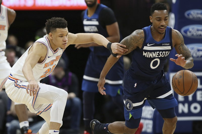 Minnesota Timberwolves' Jeff Teague steals the ball from New York Knicks' Kevin Knox in the first half of an NBA basketball game Sunday, March 10, 2019, in Minneapolis. (AP Photo/Stacy Bengs)