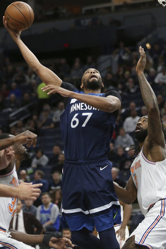 Minnesota Timberwolves' Taj Gibson shoots the ball against New York Knicks' DeAndre Jordan in the first half of an NBA basketball game Sunday, March 10, 2019, in Minneapolis. (AP Photo/Stacy Bengs)