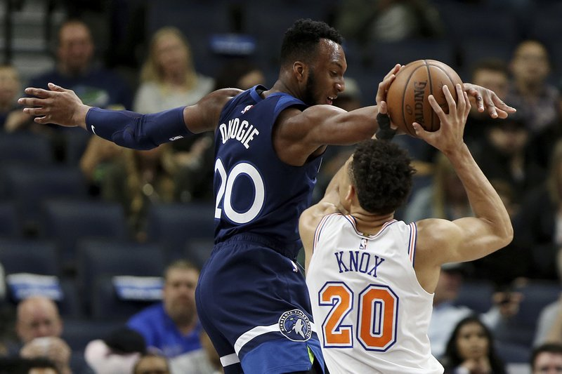 New York Knicks' Kevin Knox tries to shoot the ball over Minnesota Timberwolves' Josh Okogie in the first half of an NBA basketball game Sunday, March 10, 2019, in Minneapolis. (AP Photo/Stacy Bengs)