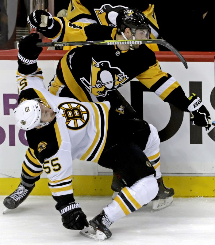 Boston Bruins' Noel Acciari (55) collides with Pittsburgh Penguins' Justin Schultz (4) in the first period of an NHL hockey game in Pittsburgh, Sunday, March 10, 2019. (AP Photo/Gene J. Puskar)