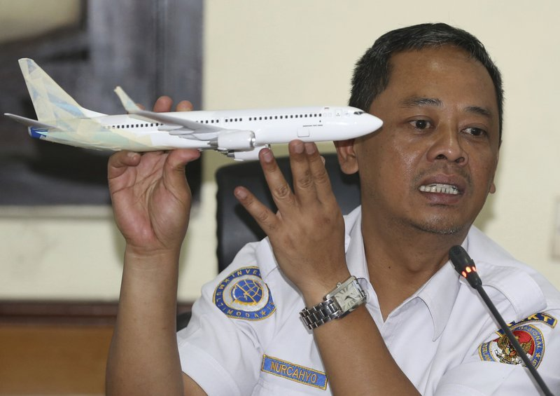 FILE - In this Nov. 28, 2018, file photo, National Transportation Safety Committee investigator Nurcahyo Utomo holds a model of an airplane during a press conference on the committee's preliminary findings on their investigation on the crash of Lion Air flight 610, in Jakarta, Indonesia. (AP Photo/Achmad Ibrahim, File)