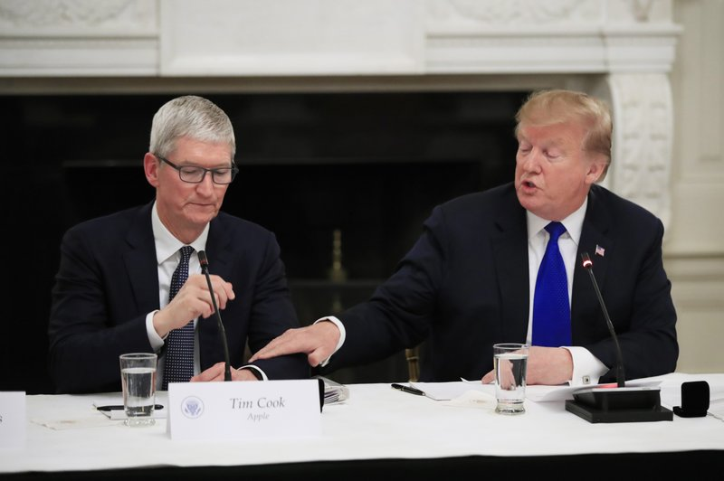 President Donald Trump acknowledges Apple Inc. CEO Tim Cook during the American Workforce Policy Advisory Board's first meeting in the State Dining Room of the White House in Washington, Wednesday, March 6, 2019. (AP Photo/Manuel Balce Ceneta)