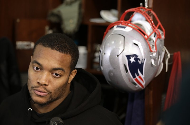 FILE - In this Jan. 18, 2018, file photo, New England Patriots defensive end Trey Flowers faces reporters in the team's locker room following an NFL football practice, in Foxborough, Mass. (AP Photo/Steven Senne, File)