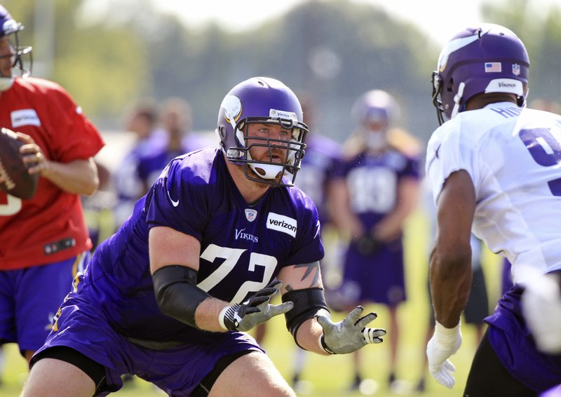 FILE - In this Friday, July 28, 2017 file photo, Minnesota Vikings tackle Mike Remmers (72) protects quarterback Sam Bradford (8) from defensive end Danielle Hunter (99) during NFL football training camp in Mankato, Minn. (AP Photo/Andy Clayton-King, File)