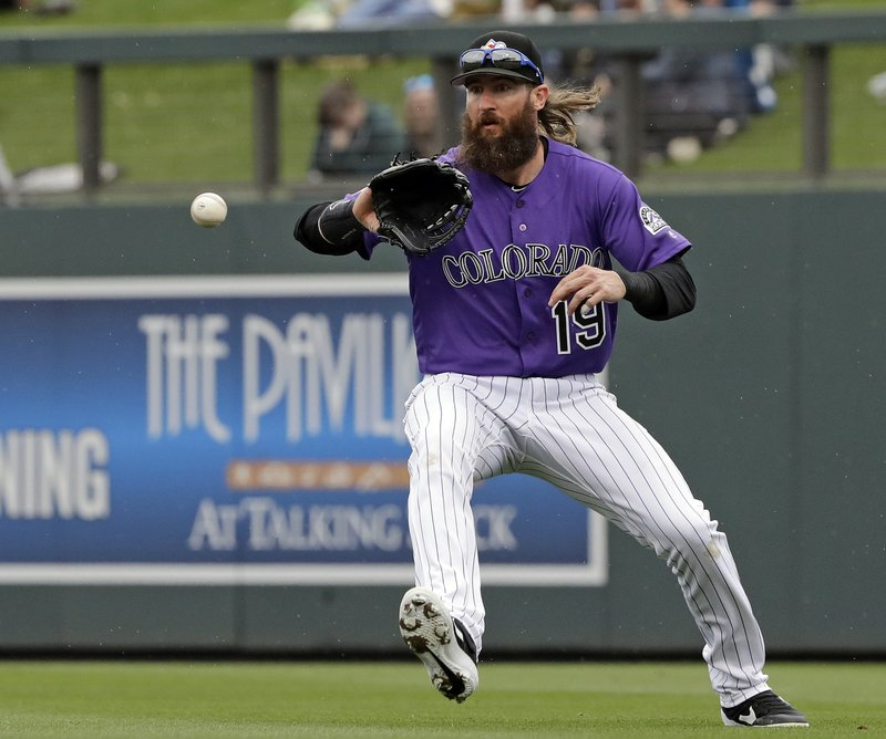 Colorado Rockies right fielder Charlie Blackmon chases a ball that fell in for a single from Oakland Athletics' Marcus Semien in the fourth inning of a spring training baseball game Monday, March 11, 2019, in Scottsdale, Ariz. (AP Photo/Elaine Thompson)